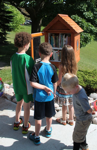 Kids looking in the little library