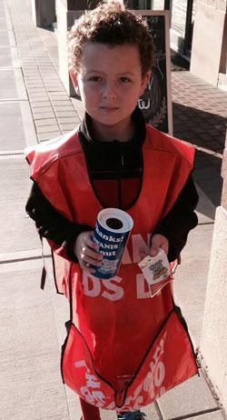 Small boy in orange kiwanis peanuts apron
