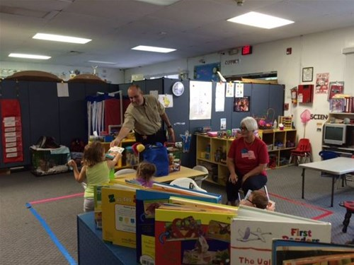 Kiwanis of the Brooksville Ridge member reading to kids through our BookWorks program sponsored by Goodwill.