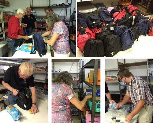 Kiwanis of the Brooksville Ridge members pack backpacks for children in need.