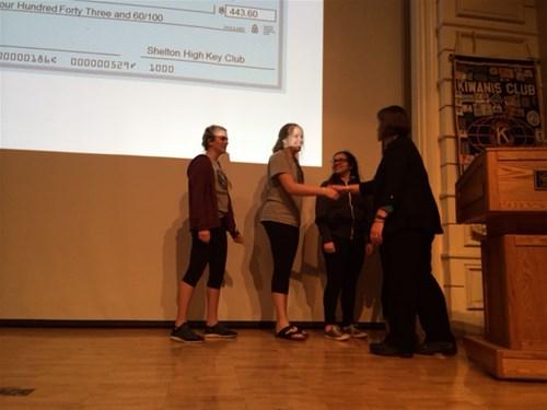 Sheldon Key Club presenting check to Kiwanis Doernbecher Children's Cancer Program